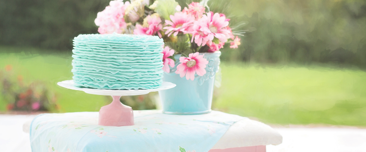 Blue cake and pink flowers