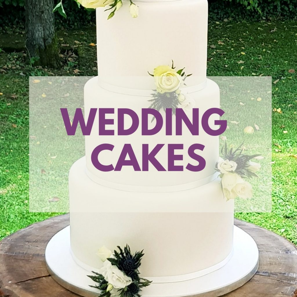 "Wedding cake with overlapping text saying ""Wedding Cakes"""