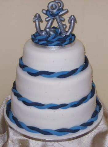 Anchor themed 3 tier white wedding cake with twisted blue rope detail