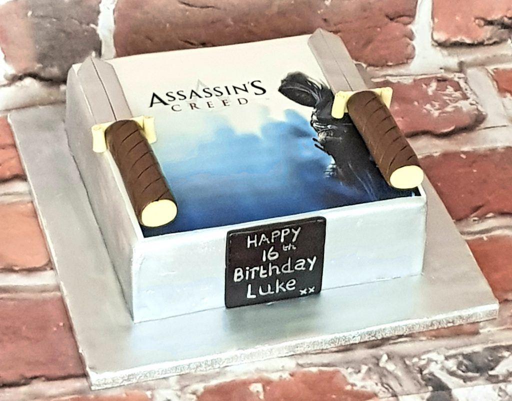 Assassin's Creed themed birthday cake with daggers