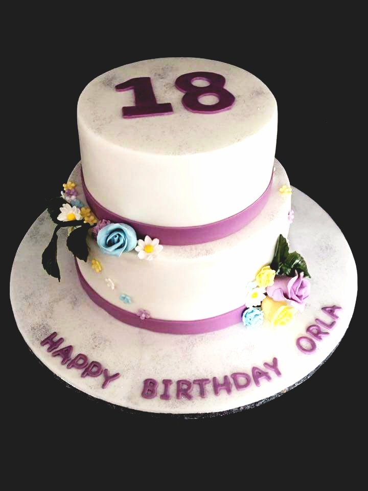 Classic white and purple themed tiered 18th birthday cakea