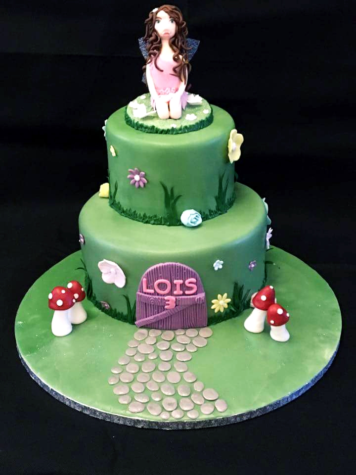 Fairy themed tiered birthday cake