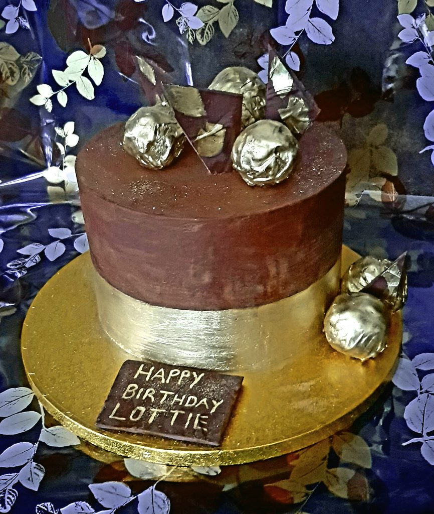 Chocolate and gold leaf birthday cake