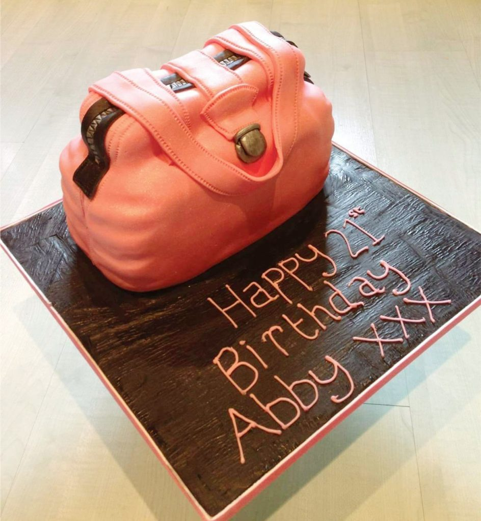 Coral coloured handbag birthday cake