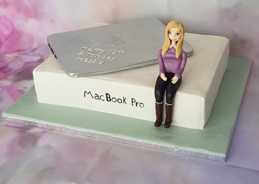 18th birthday cake with Macbook Pro and girl sitting on the top