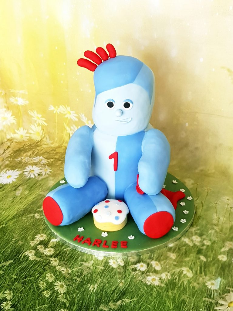 Soft blue and red toy birthday cake
