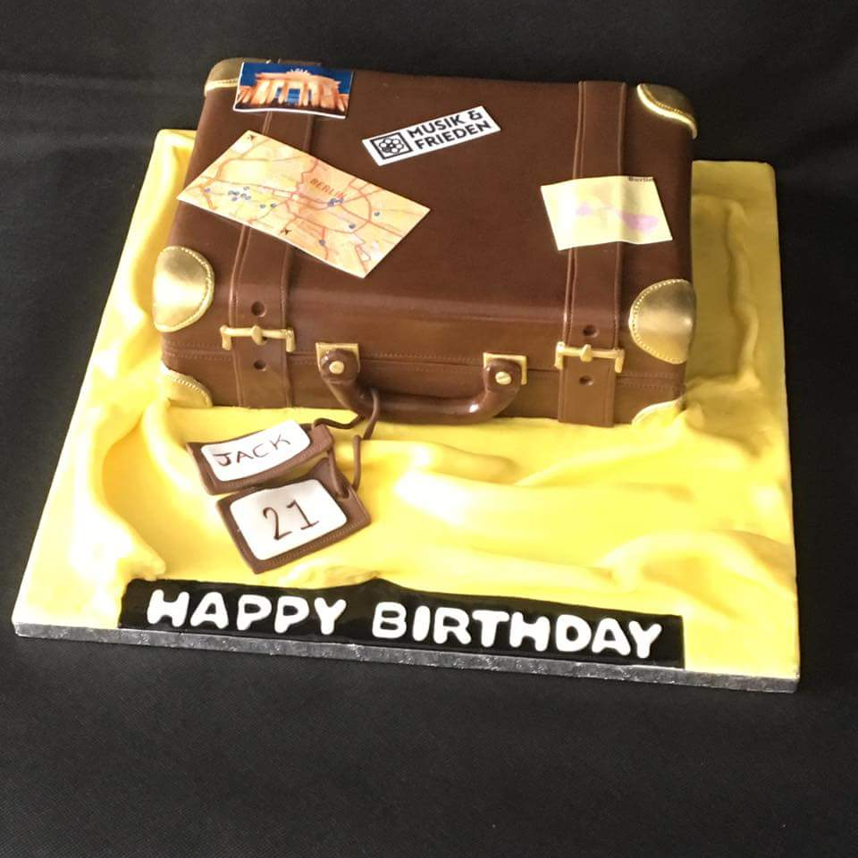 Brown suitcase travel themed 21st birthday cake