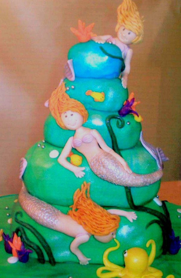 Under the sea themed birthday cake with mermaids, octopus and shells