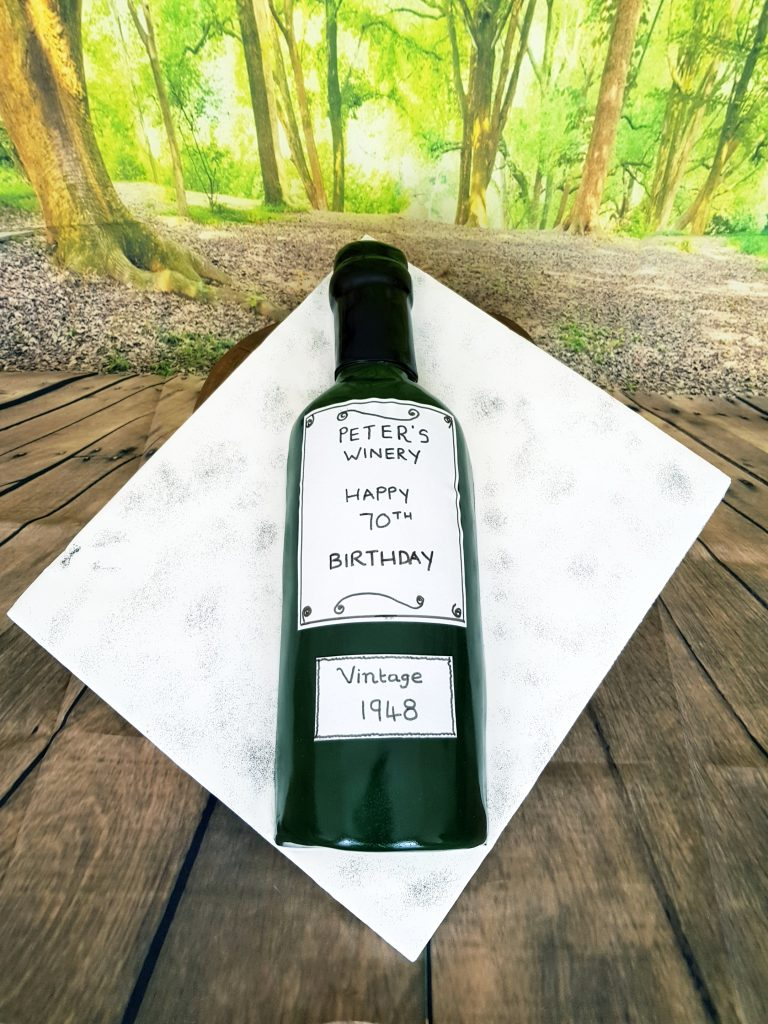 70th birthday cake in the shape of a green wine bottle