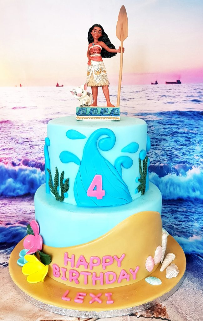 Moana cartoon topped blue cake