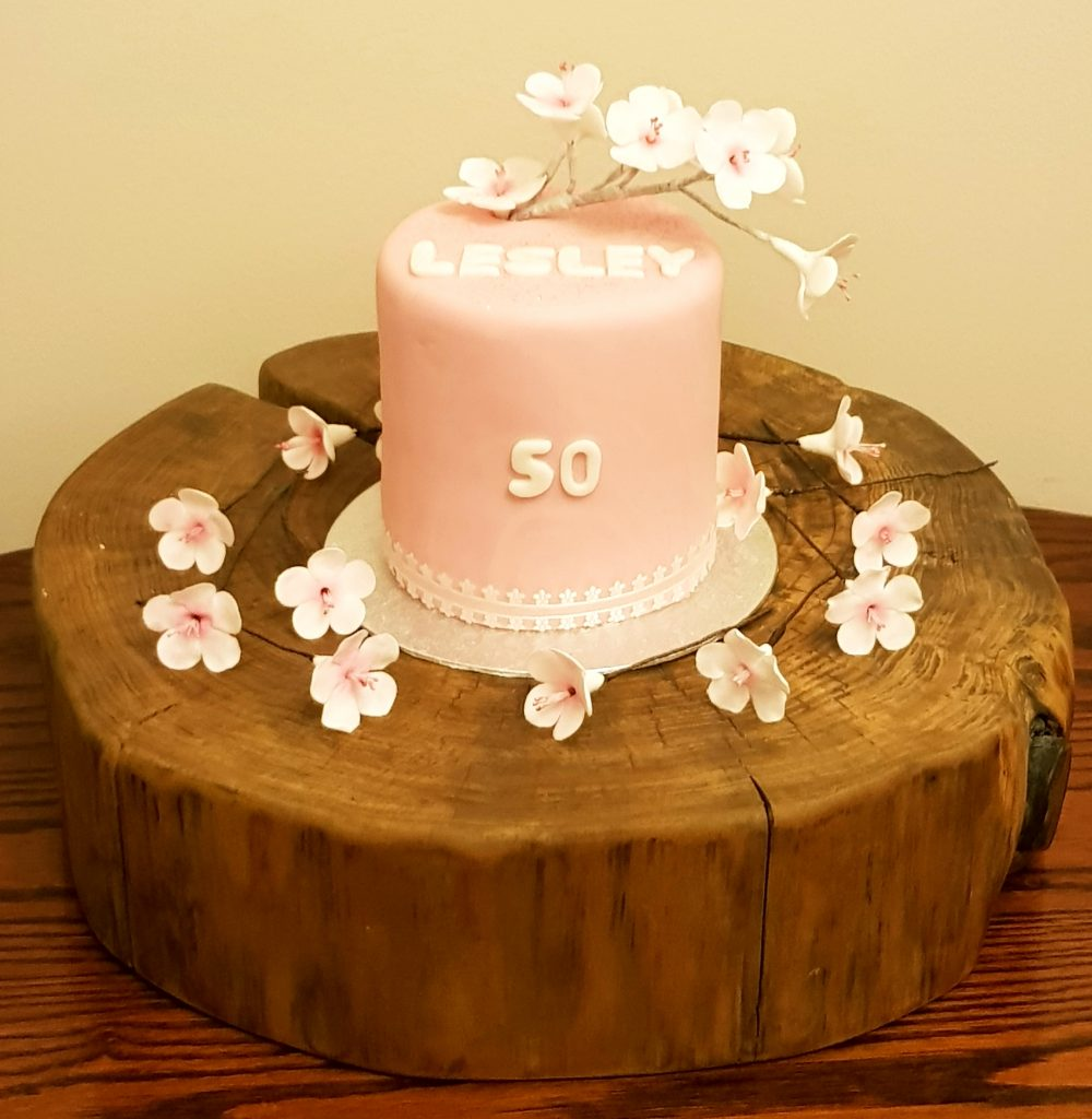Pink cake with japanese white blossom detail